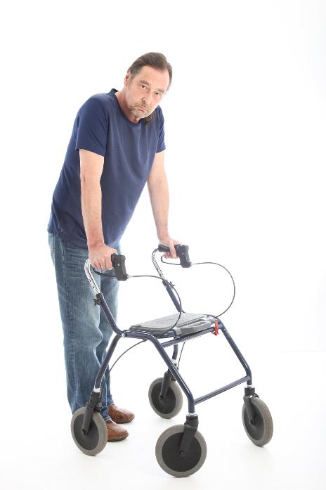 bigstock-Man-Walking-With-A-Medical-Wal-35161928.jpg